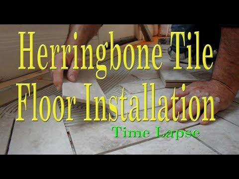 Herringbone tile floor installation with border Time Lapse