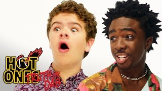 Download Stranger Things' Caleb McLaughlin and Gaten Matarazzo Play Truth or Dab | Hot Ones Video
