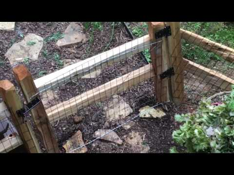 Dog fence installed at the cabin. Split rail and hog wire
