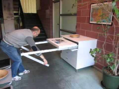 Folding away a pull out kitchen table frame
