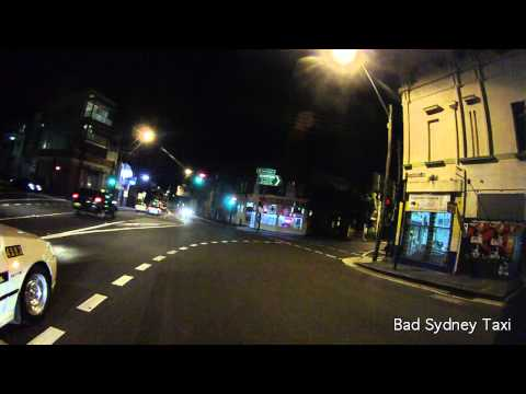 11-5-12 TCS taxi cab creeps and jumps red light - Redfern Sydney