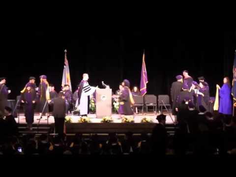 Kyla Moore walks across stage at University of Michigan Law School Graduation
