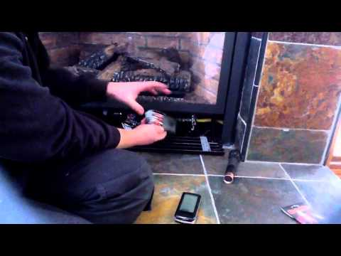 How to change fireplace remote batteries