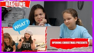 REACTING TO OUR OLD CHRISTMAS VIDEOS | SISTER FOREVER