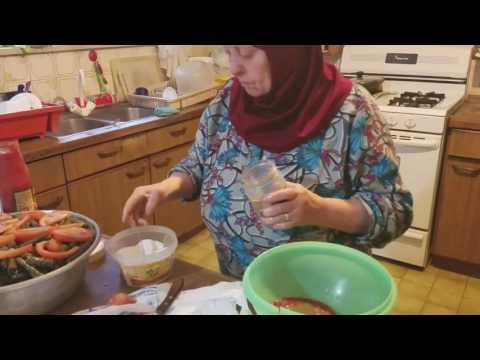 Hajjeh Zakiyeh assembles Mahshi and Dawali (stuffed grape leaves)