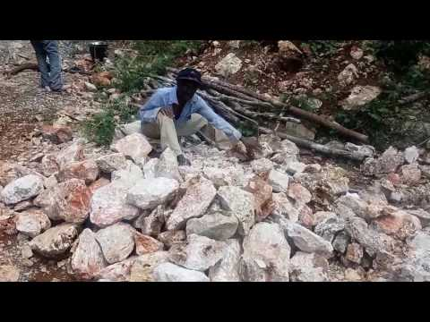 Building a House - Stone Wall Cutting  in Red Hills Jamaica