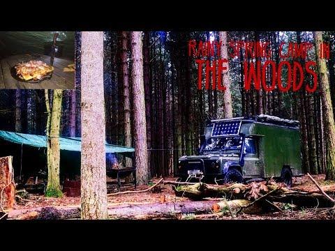 Landrover camper van wet weekend in the woods.