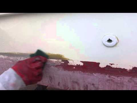 cleaning the waterline on a boat