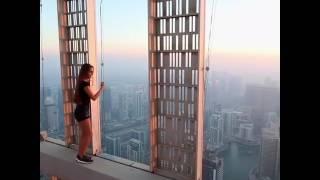 Viki odintcova dangerous selfi at  1004 feet hight dubai skyscraper cayan tower