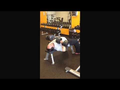 Shawn Patterson repping out some 100 lb. dumbbell bench press