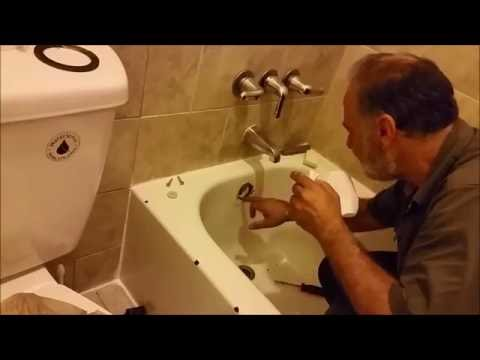 How to Replace a Leaky bath tub Overflow Drain Gasket and Trip Lever Stopper