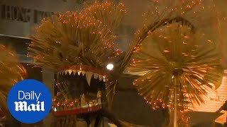 Fire dragon dances in Hong Kong streets during Mid-Autumn festival