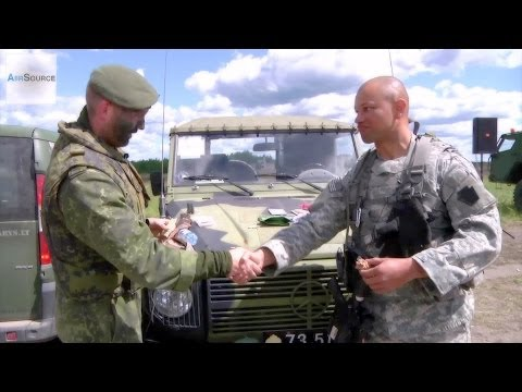 U.S. and Denmark Soldiers Trade MRE Meals