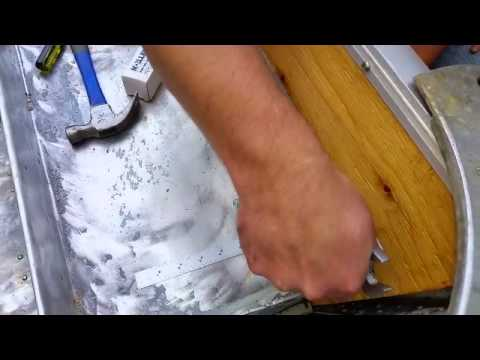 Using a Flanging Tool to Install a Drain Tube on a Boat Transom