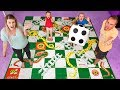 Giant Board Game Challenge Playing Giant Snakes And Ladders