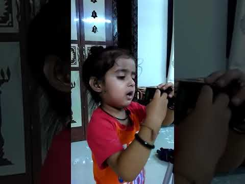 Krishiv repairing Tripod at 2.5 years
