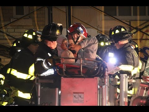FDNY L114 rescues worker who fell on scaffolding