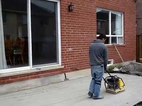 Interlocking stone patio and driveway installation