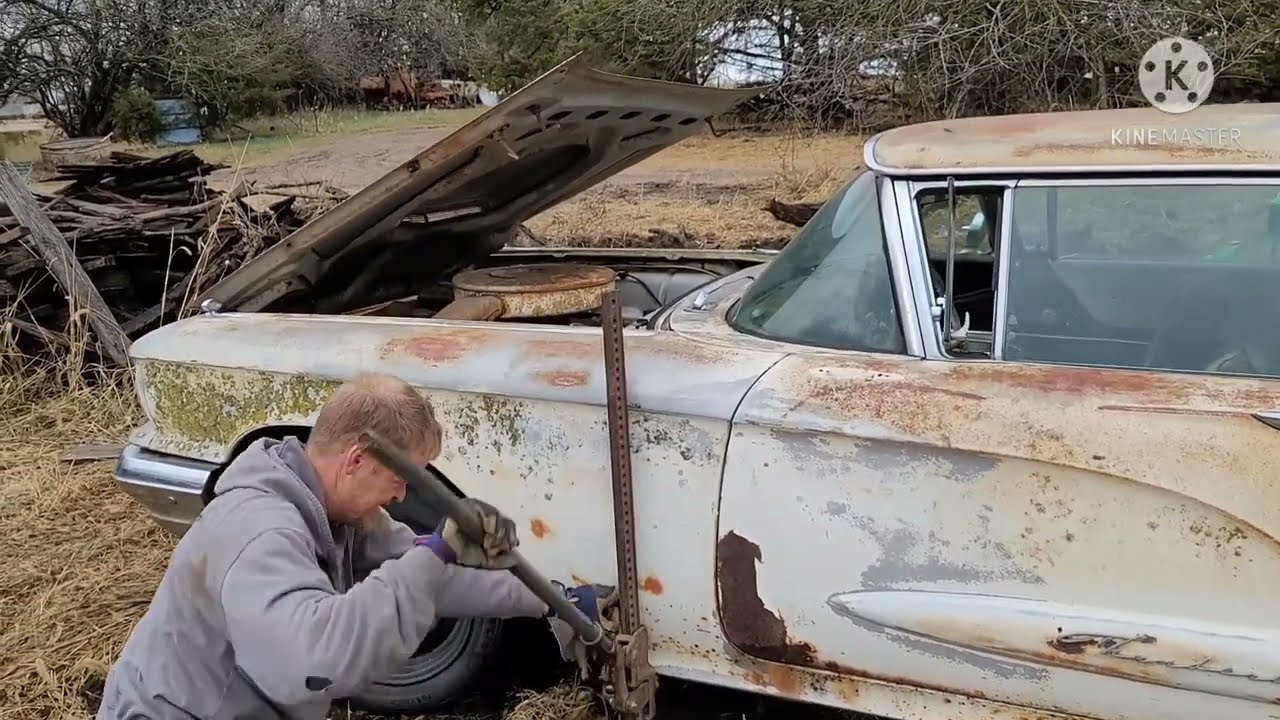 We rescue a 1960 Thunderbird from the abandoned farmstead: Out of the mud, and onto the trailer!