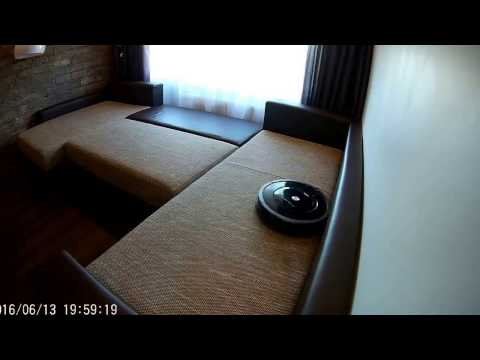 IROBOT ROOMBA 880 cleaning couch.