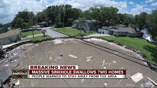 Massive sinkhole swallows two homes