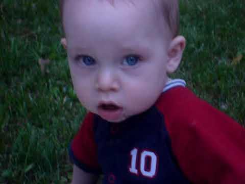 Baby Rowan throws a ball