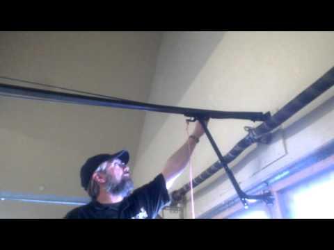 Garage door opener   stretched belt